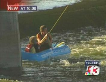 Wanek and Treptow in raft trapped at Scott Street dam